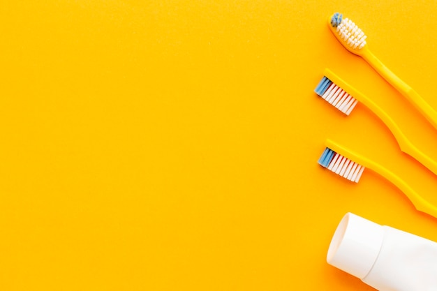 Top view collection of toothbrushes with copy space