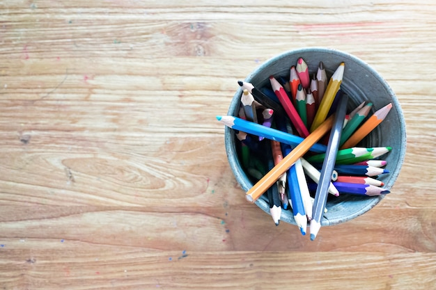 Top view color pencil on wooden table with copy space