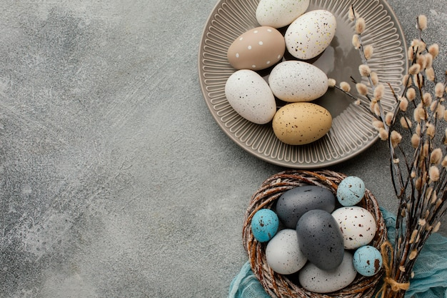 Top view of colored easter eggs in basket and plate with copy space