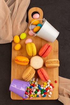 A top view colored french macarons with yummy candies