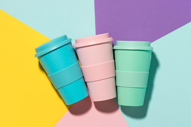 Top view colored reusable cups on the table