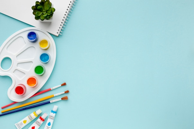 Top view of colorful aquarelle and copy space