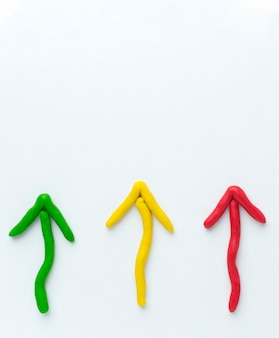 Top view of colorful arrows pointing up