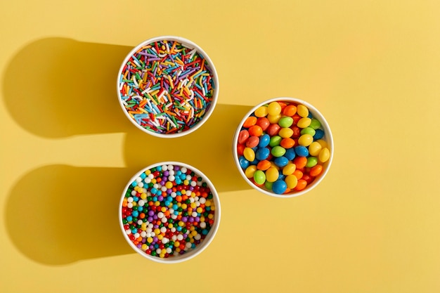 Top view of colorful assortment of candy in cup