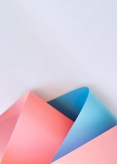 Top view of colorful bent papers with copy space