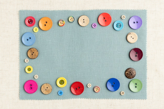 Top view colorful buttons on cloth