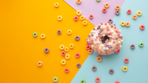 Top view colorful cereal and doughnut