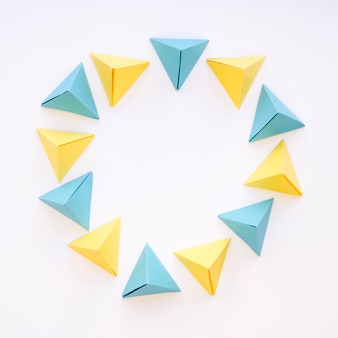 Top view of colorful circle of paper pyramids