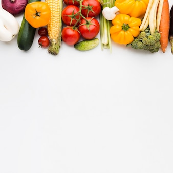 Top view colorful composition of vegetables with copy space