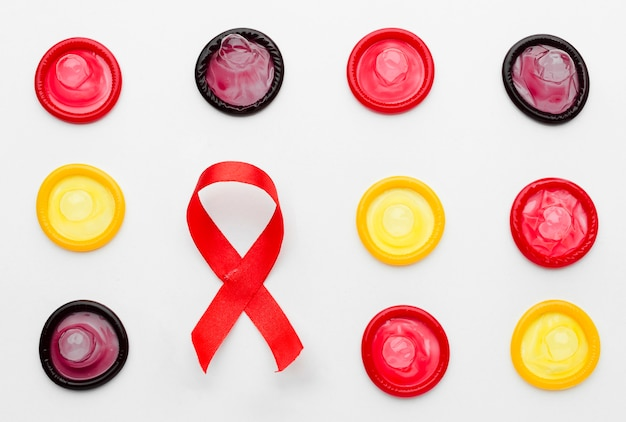 Top view colorful condoms on white background