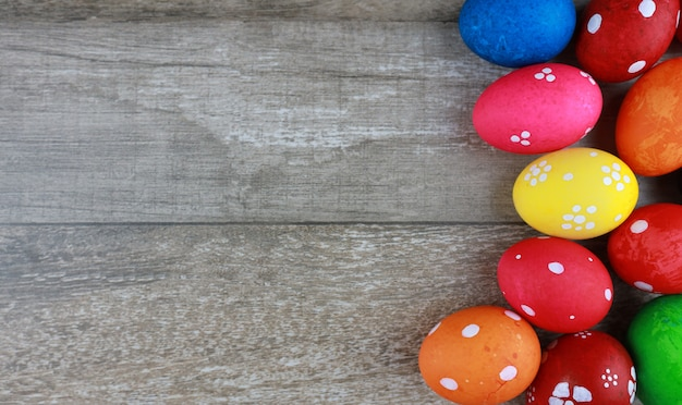 Top view colorful and decorated easter eggs on vintage wooden table background. advertising image easter festival concept with free space.