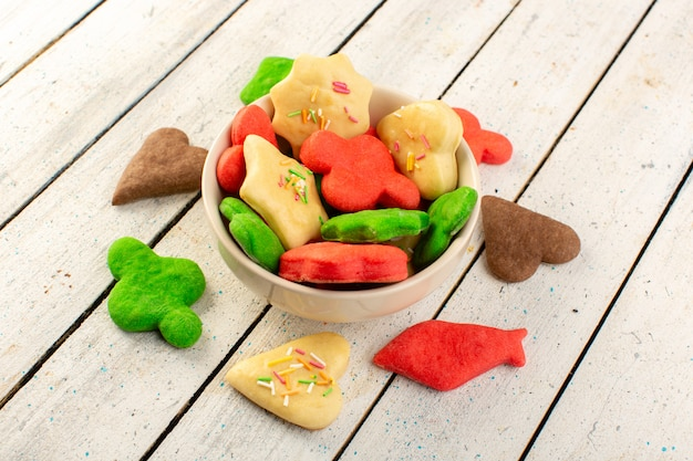 Top view of colorful delicious cookies different formed multicolored inside round plate