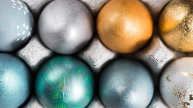 Top view of colorful easter eggs in carton