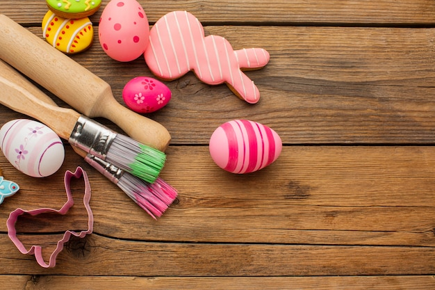 Top view of colorful easter eggs with copy space and kitchen utensils
