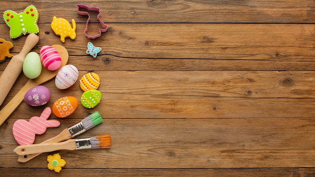 Top view of colorful easter eggs with kitchen utensils and copy space