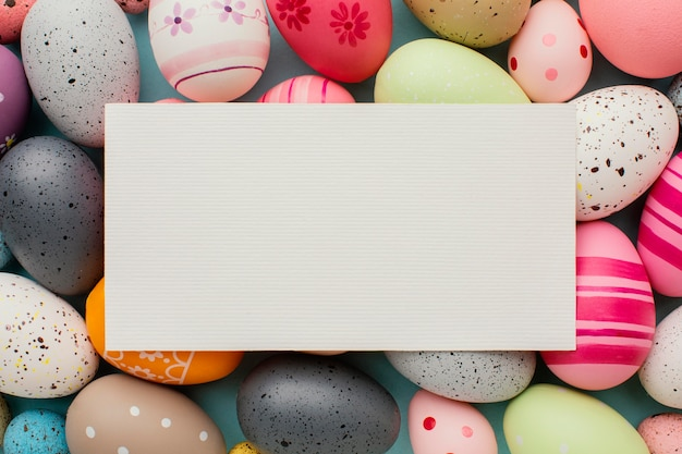 Top view of colorful easter eggs with paper
