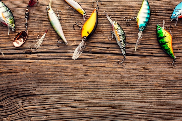 Top view of colorful fishing bait with copy space