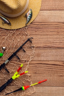 Top view of colorful fishing hat with essentials