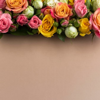 Top view of colorful flowers with copy space