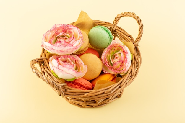 A top view colorful french macarons inside basket