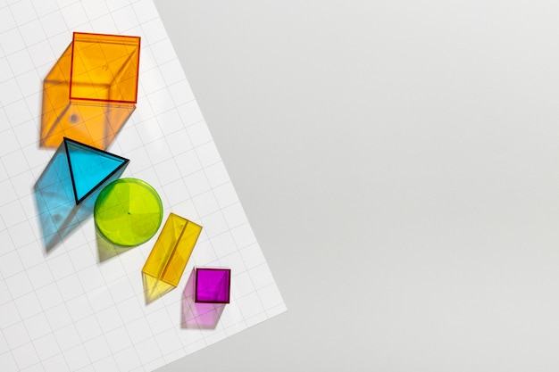 Top view of colorful geometric forms with copy space