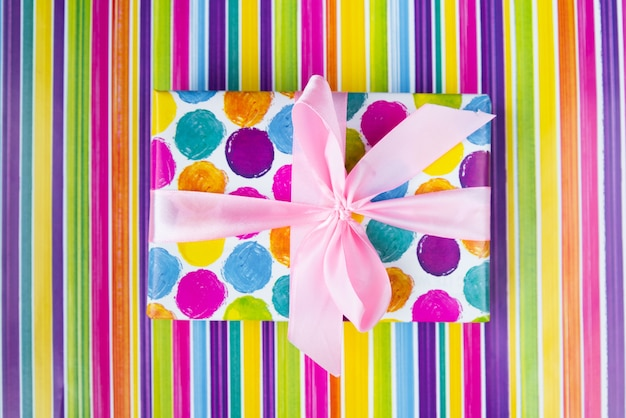 Top view colorful gift on colorful background