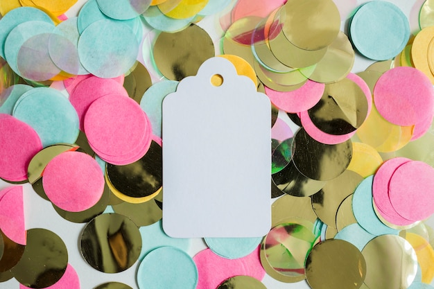 Top view colorful golden confetti with label
