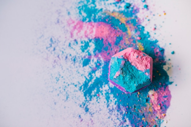 Top view of colorful hexagonal shape bath bomb on white background