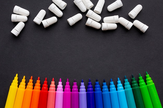 Top view of colorful markers with copy space