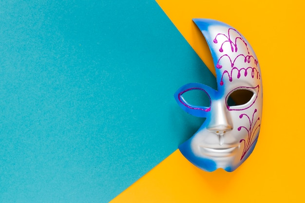 Top view of colorful mask for carnival with copy space