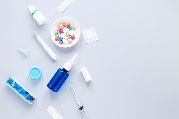 Top view colorful medicine with pillbox on the table