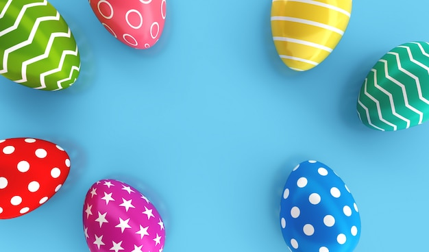 Top view of colorful painted easter eggs on blue floor background