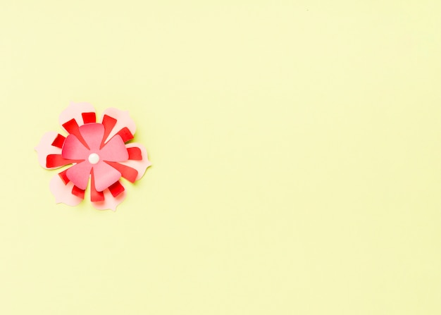 Top view of colorful paper spring flower with copy space