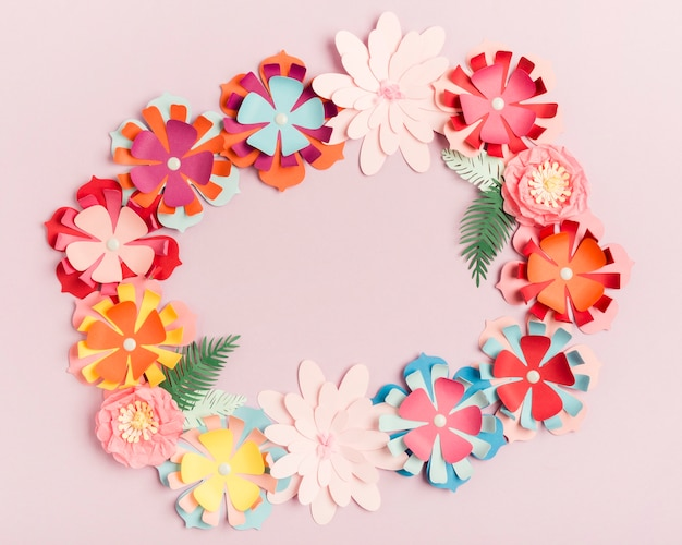 Top view of colorful paper spring flowers wreath