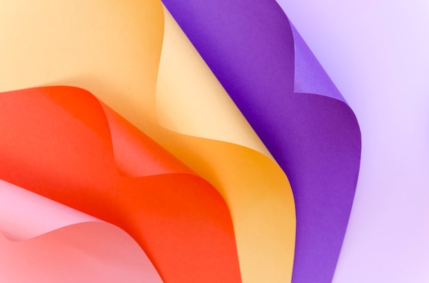 Top view of colorful paper with bent corners