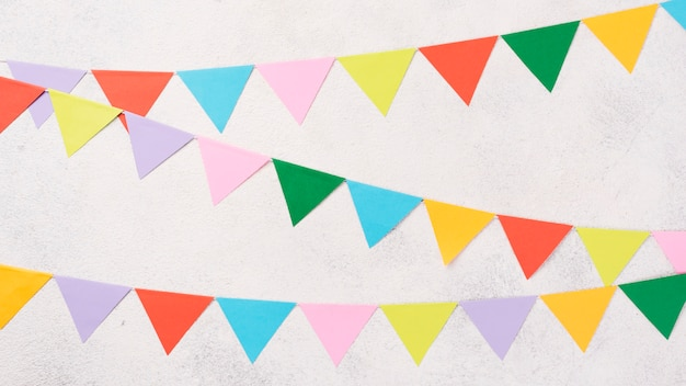 Top view colorful party decorations on stucco background
