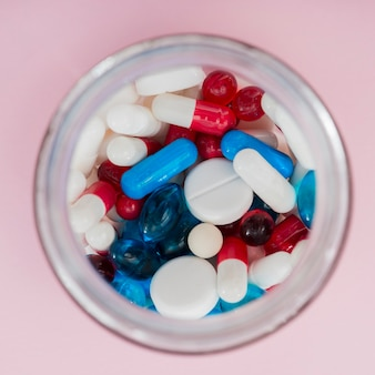 Top view colorful pills in jar