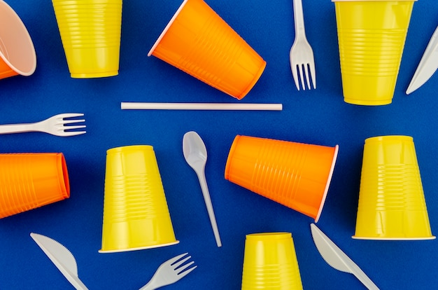 Top view colorful plastic disposable cutlery