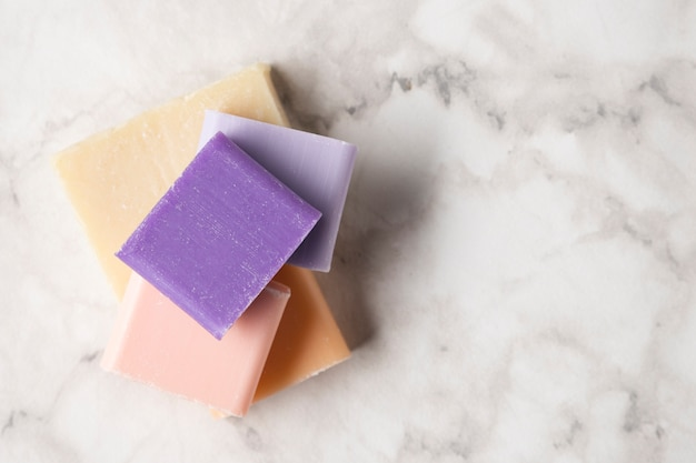 Top view colorful soaps on marble background