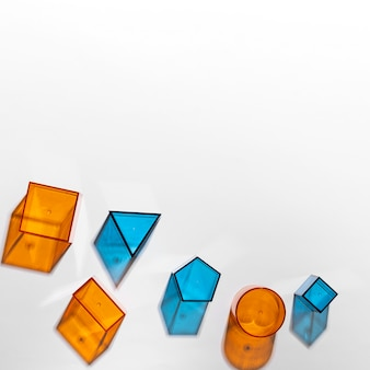 Top view of colorful translucent shapes with copy space
