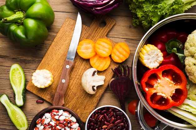 Top view colorful vegetables assortment on wooden background