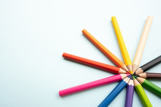 Top view of colourful crayons or colour pencil set in range
