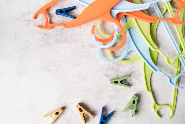 Top view colourful hangers with pegs