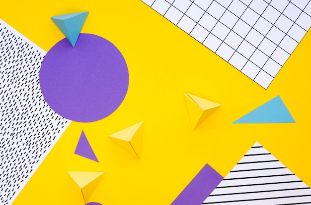 Top view of colourful paper pyramids and cut-outs