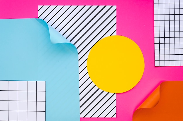 Top view of colourful paper shapes and sheets