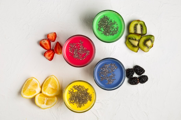 Top view colourful smoothies in glasses