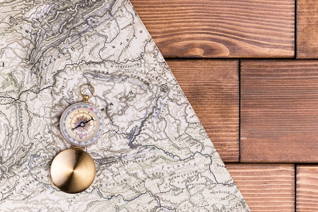 Top view compass on top of world map with copy space