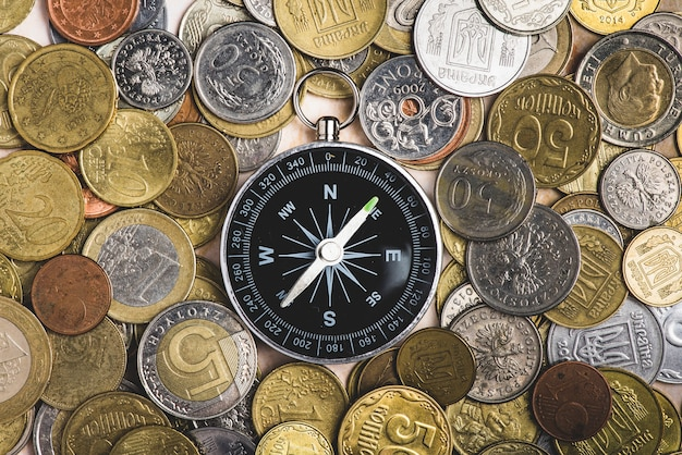 Top view of compass with many coins