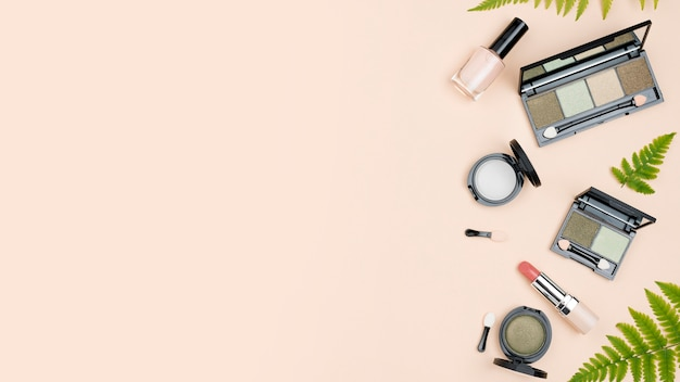 Top view composition of beauty products with copy space