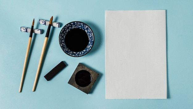 Top view composition of chinese ink with empty card